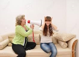 parent yelling into megaphone pointed at student
