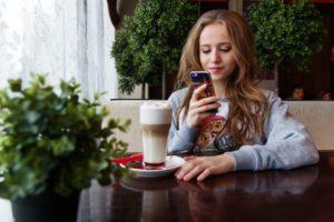 teenage student looking at phone
