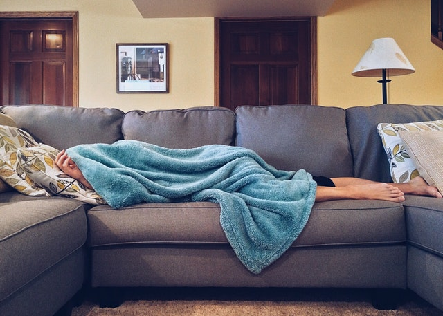 college student lying on couch